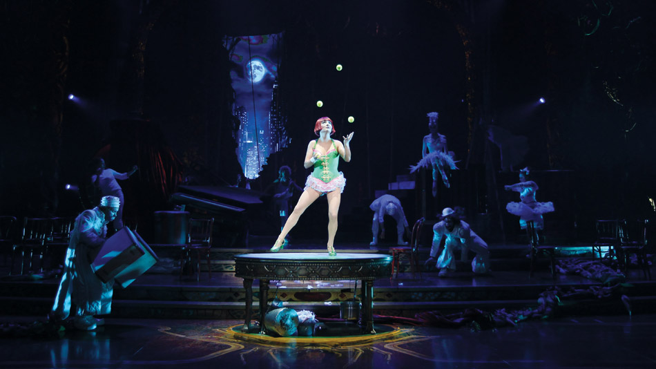 A breach in the set reveals the animated view of a gothic metropolis.  (Photo: Cirque du Soleil)