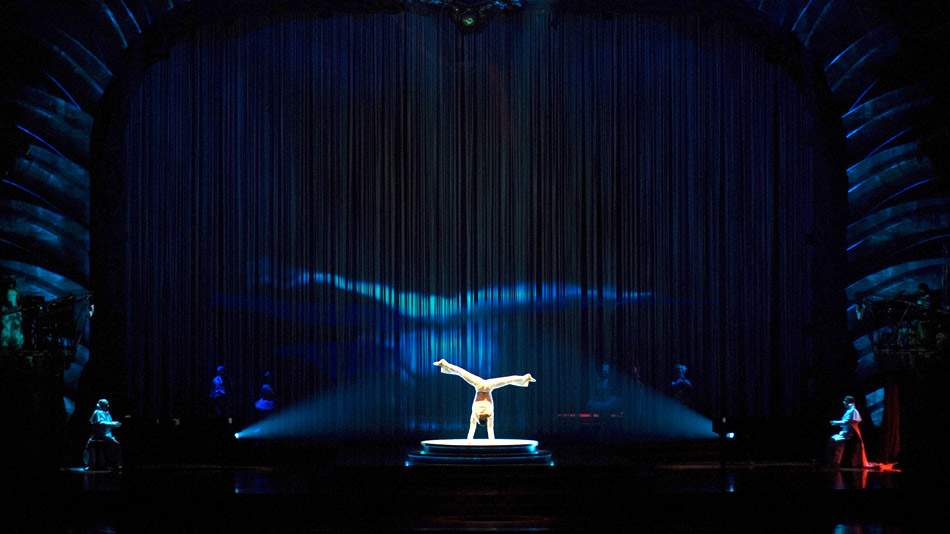 The silhouette of the acrobat is projected with a live fluid dynamics effect.  (Photo: Simon Pelletier)