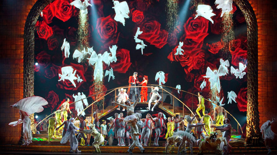 The angels in the background were filmed in studio and composited with the video animation.  (Photo: Cirque du Soleil)